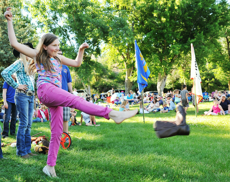 10-year-old Lotus Brandov kicks off her boot during the annual Sheridan-Wyo-Rodeo Boot Kick-off Tuesday afternoon at Kendrick Park.