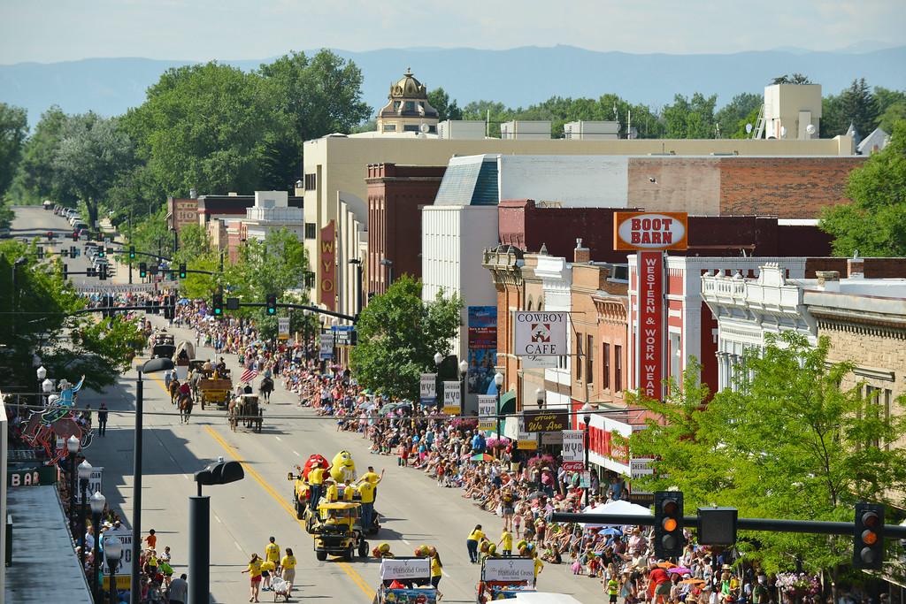 Parade floats and spectators fill Main Street during the 2014 Sheridan WYO Rodeo Parade Friday morning. The Sheridan Press|Justin Sheely.