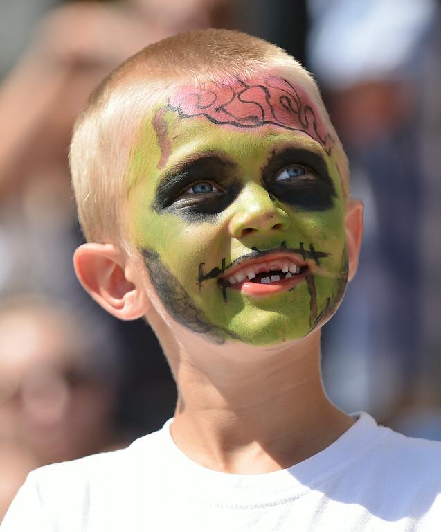 Six-year-old Cash Kula wears zombie face paint during the 2014 Sheridan WYO Rodeo Parade Friday morning on Main Street. The Sheridan Press|Justin Sheely.