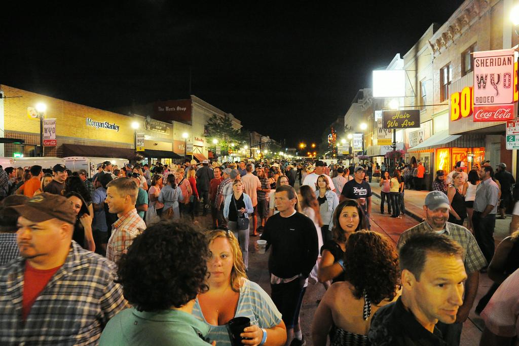 Partygoers mingle during the Sheridan WYO Rodeo Street Dance Saturday night on Main Street. The Sheridan Press|Justin Sheely.