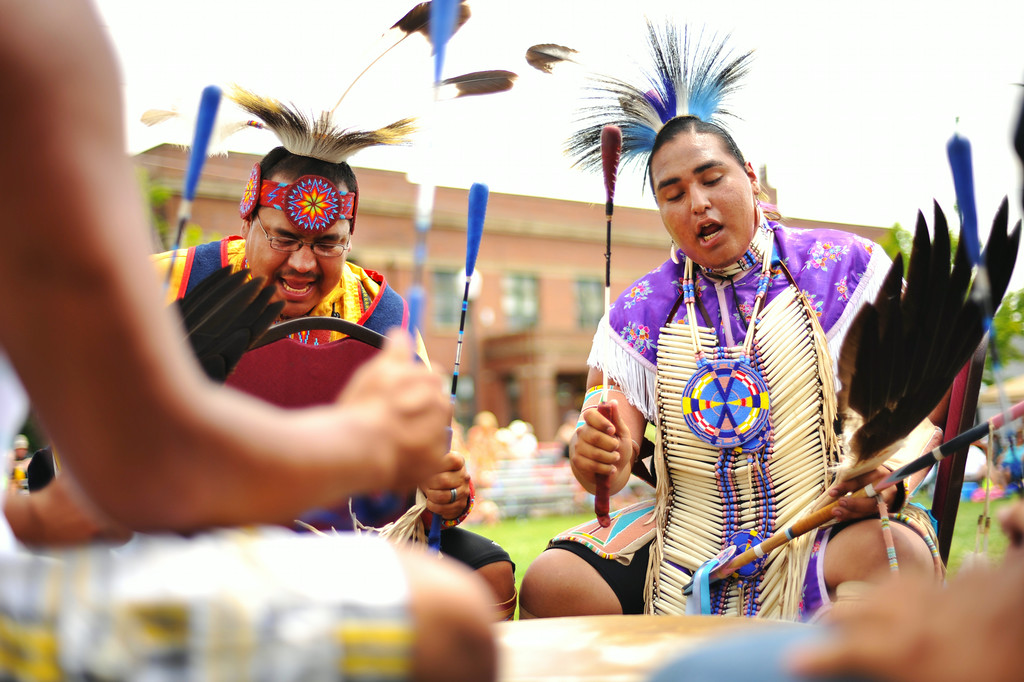 Bucky Old Elk of the Crow Nation, left, and August Scalp of Lame Deer, Montana, sing as they beat the drum during the powwow after the parade Friday afternoon at the historic Sheridan Inn. The Sheridan Press|Justin Sheely.
