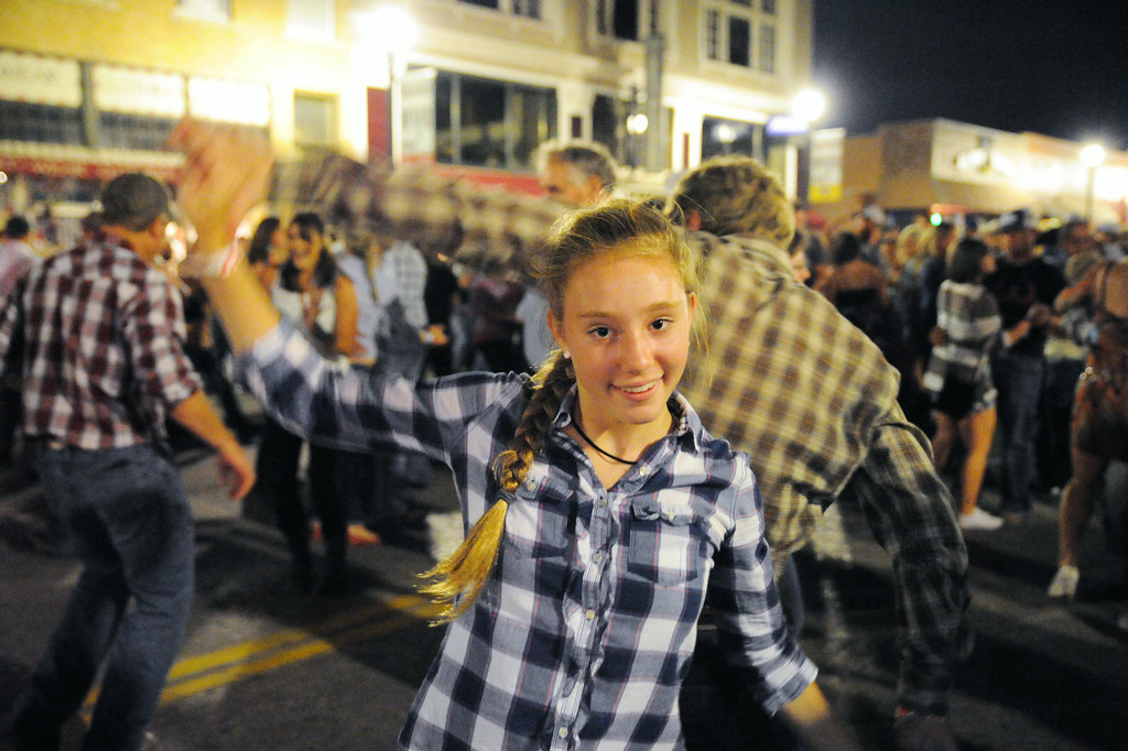 Peyton Bomar dances with her partner Chris Romanjenko during the Sheridan WYO Rodeo Street Dance Saturday night on Main Street. The Sheridan Press|Justin Sheely.