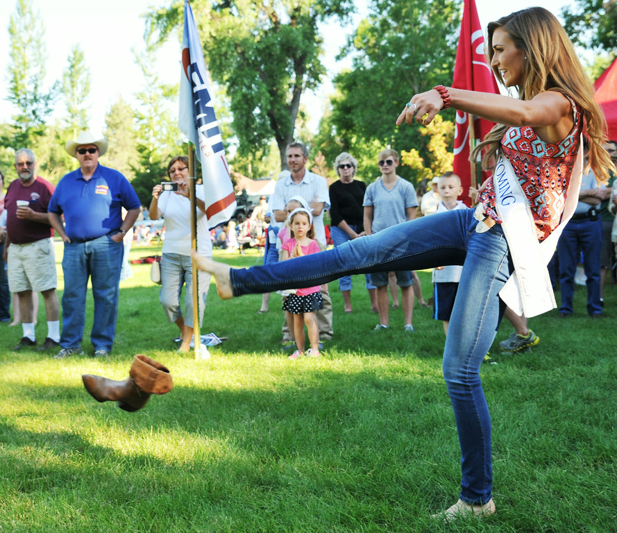 Miss Wyoming 2014 Jessie Allen kicks a boot off her foot in the annual Sheridan-Wyo-Rodeo Boot Kick-off Tuesday at Kendrick Park.