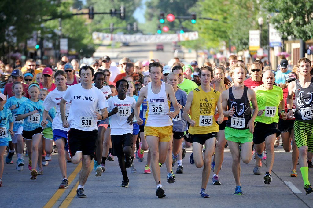 Runners in the Sneakers and Spurs Rodeo 5K take off from the starting line on Main Street on Friday. Over 350 runners competed in the race. The Sheridan Press|Mike Pruden