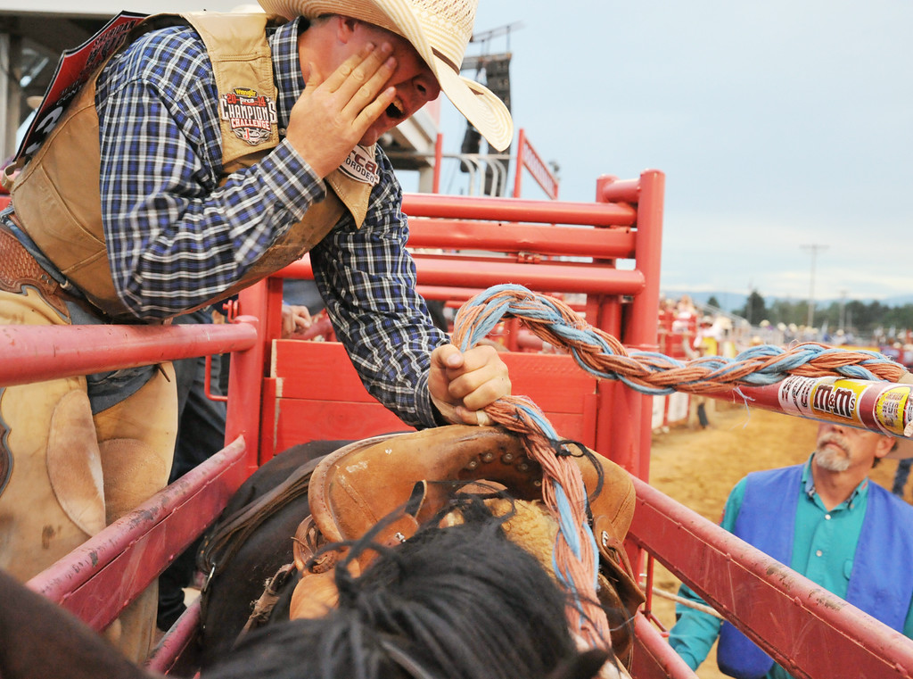 Oregon man Ryan Mackenzie slaps himself on the face before mounting on his saddle bronc during the first night of the Sheridan WYO Rodeo Wednesday athte Sheridan County Fairgrounds. The Sheridan Press|Justin Sheely.