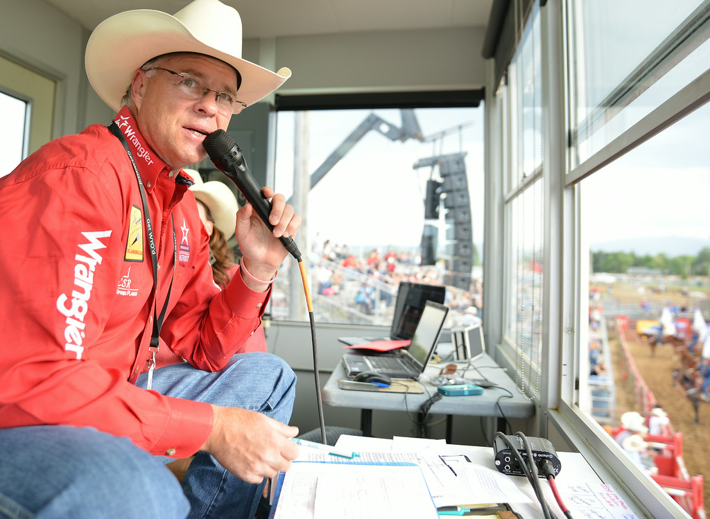 Sheridan's favorite rodeo announcer Will Rasmussen starts the event with opening statements from the box Thursday evening during the Sheridan WYO Rodeo. The Sheridan Press Justin Sheely.