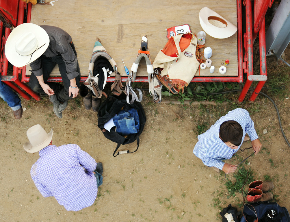 Bareback riding competitors get ready for the competition during the Sheridan WYO Rodeo Thursday at the Sheridan County Fairgrounds. The Sheridan Press|Justin Sheely.