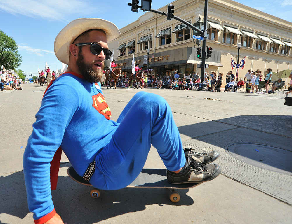 Brady McLean rolls around dressed as superman during the 2014 Sheridan WYO Rodeo Parade Friday morning on Main Street. The Sheridan Press|Justin Sheely.