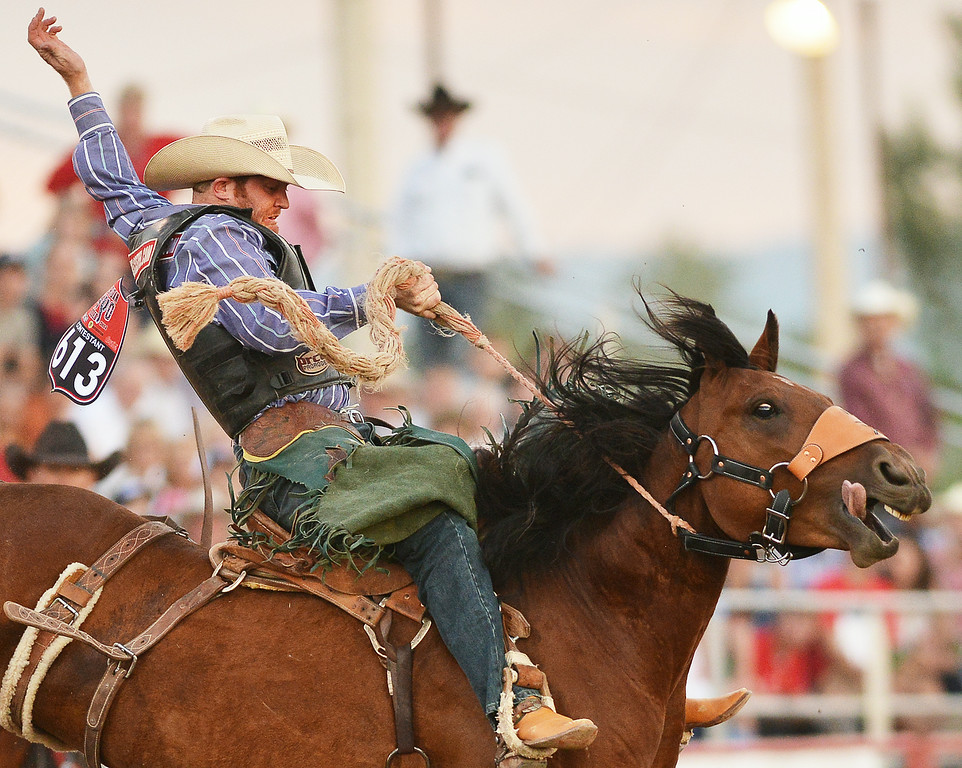 Dean Wadsworth of Ozona, Texas, competes in saddle bronc riding Thursday night at the Sheridan County Fairgrounds. The Sheridan Press|Justin Sheely.