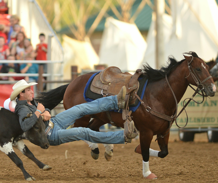Scott Guenthner of Alabama competes in steer wrestling during the Sheridan WYO Rodeo Thursday night at the Sheridan County Fairgrounds. The Sheridan Press|Justin Sheely.