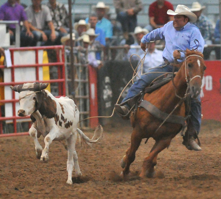 Landon McClaugherty tosses his lasso around the steer on Wednesday at the Sheridan County Fairgrounds. The Sheridan Press|Mike Pruden