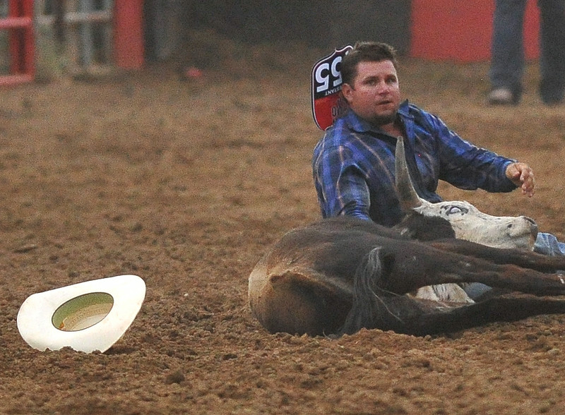 Kamry Dymmek breathes easy after wrestling his steer to the ground on Wednesday at the Sheridan WYO Rodeo. Dymmek's time of 5.1 seconds was enough to put him in first after the first day of competition. The Sheridan Press Mike Pruden