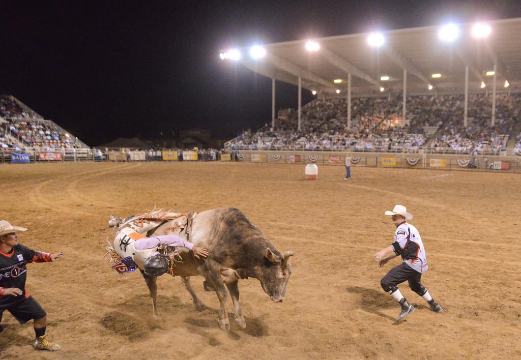 Dalan Duncan of Ballard, Utah, competes in bull riding during the Sheridan WYO Rodeo Saturday night at the Sheridan County Fairgrounds. Justin Sheely/The Sheridan Press.