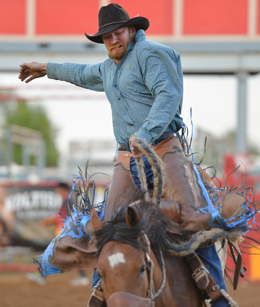 Justin Sheely | The Sheridan Press<br /> Dusten Turner competes in the saddle bronc riding event during the Sheridan County Rodeo Friday evening at the Sheridan County Fairgrounds. Performances continue Saturday at 1 p.m. and 7p.m. and Sunday at 1 p.m.
