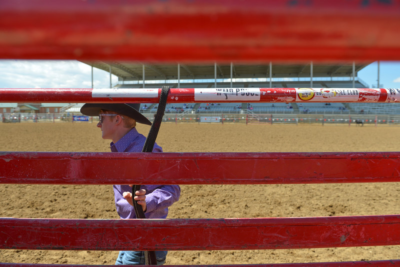 Justin Sheely | The Sheridan Press<br /> A volunteer stands by the bucking chutes during the Saturday afternoon performance of the Sheridan County Rodeo at the Sheridan County Fairgrounds. Many of the contestants and their families volunteer in the various rodeo events throughout the weekend.