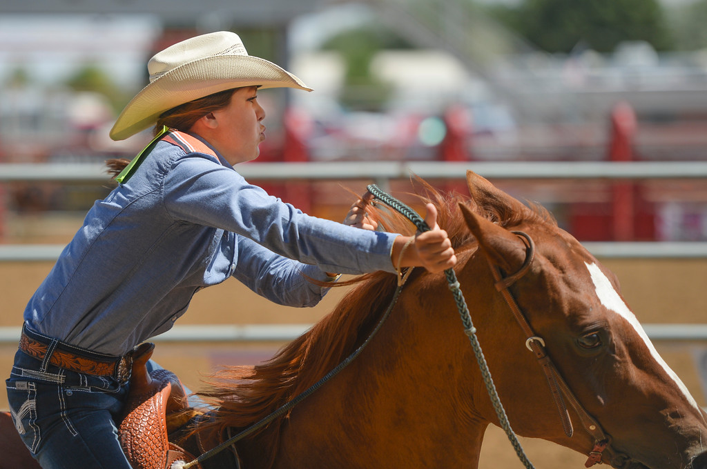 Justin Sheely | The Sheridan Press<br /> Ellie Bard competes in pole bending during the Saturday afternoon performance of the Sheridan County Rodeo at the Sheridan County Fairgrounds.