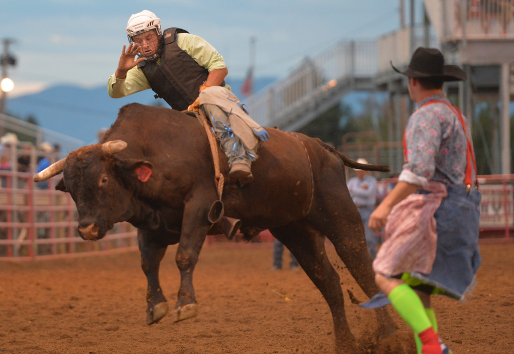 Justin Sheely | The Sheridan Press<br /> Matt Zier goes bull riding during the Sheridan County Rodeo Friday evening at the Sheridan County Fairgrounds. Performances continue Saturday at 1 p.m. and 7 p.m. and Sunday at 1 p.m.