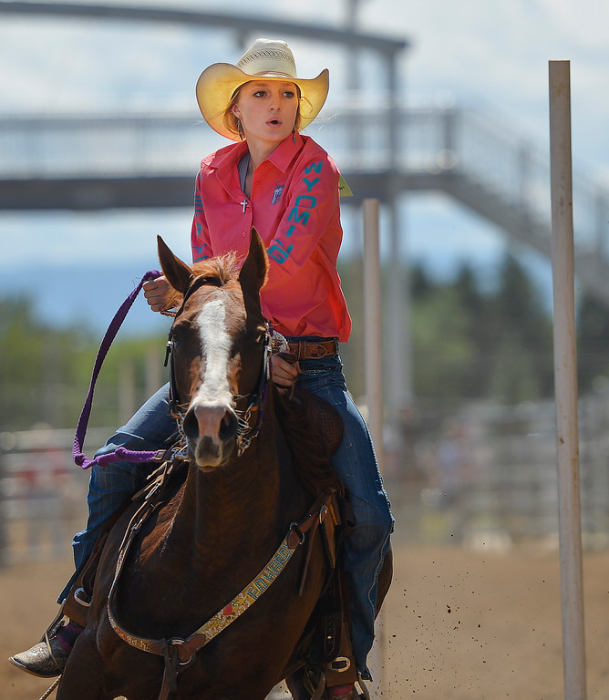 Justin Sheely | The Sheridan Press<br /> Kade Koltiska competes in pole bending during the Saturday afternoon performance of the Sheridan County Rodeo at the Sheridan County Fairgrounds.