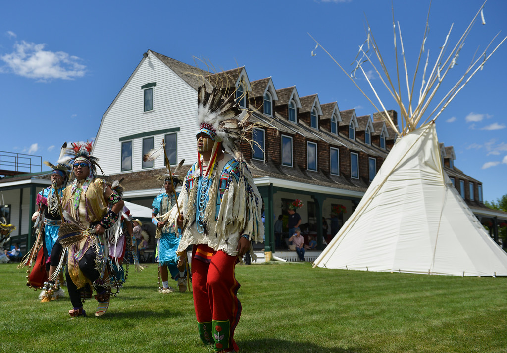 Justin Sheely   The Sheridan Press<br /> Dancers step to the beat during the Crow Powwow Wednesday at the historic Sheridan Inn.