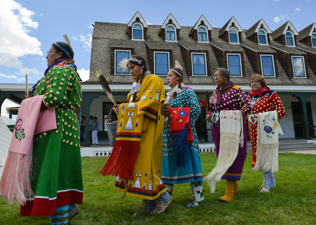 Justin Sheely | The Sheridan Press<br /> Crow women walk past the teepee during the Crow Powwow Wednesday at the historic Sheridan Inn.