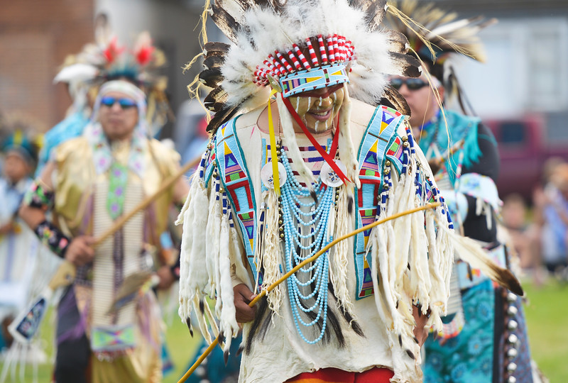 Justin Sheely | The Sheridan Press<br /> Dancers step to the beat during the Crow Powwow Wednesday at the historic Sheridan Inn.