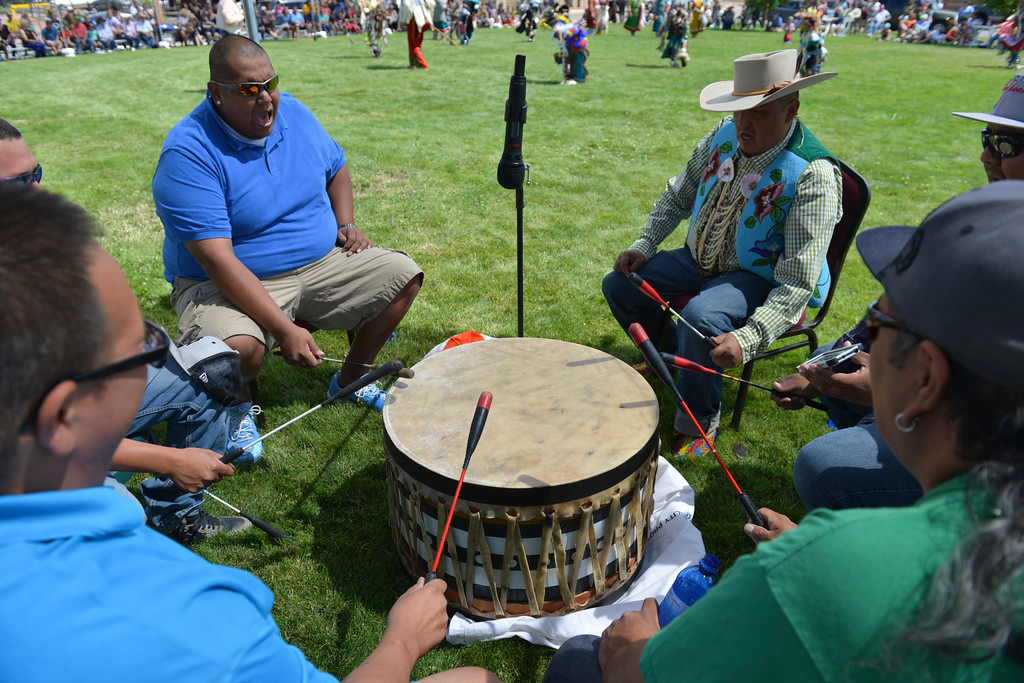 Justin Sheely   The Sheridan Press<br /> The drummers sing at the drum circle during the Crow Powwow Wednesday at the historic Sheridan Inn.