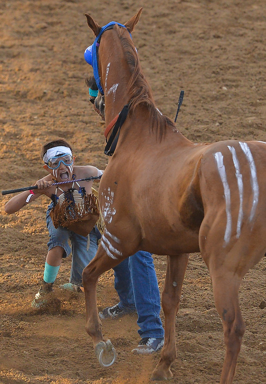 Justin Sheely | The Sheridan Press<br /> Twelve-year-old Catcher His Bad Horse stands up after jumping off his first horse for the World Champion Indian Relay Races during the first night of the Sheridan WYO Rodeo Wednesday at the Sheridan County Fairgrounds.