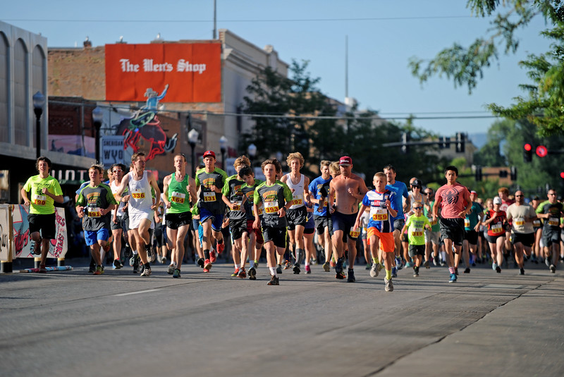 Mike Pruden | The Sheridan Press<br /> Participants take off down Main Street during the Sneakers and Spurs race in downtown Sheridan.