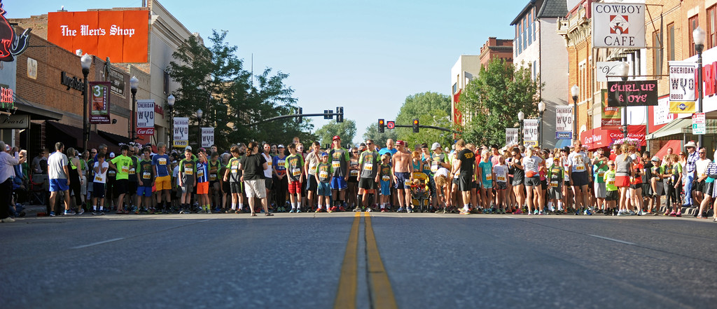 Mike Pruden | The Sheridan Press<br /> Runners line up at the starting line before the Sneakers and Spurs race on Main Street in downtown Sheridan.