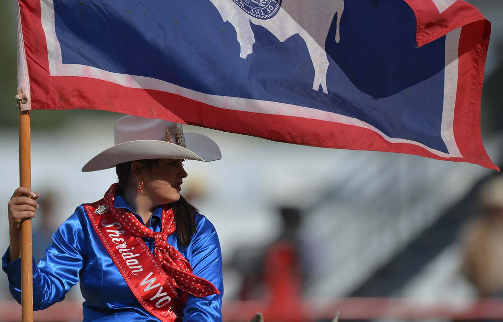 Justin Sheely | The Sheridan Press<br /> Miss Sheridan WYO Rodeo Bailey McLean carries the Wyoming State flag into the arena prior to the start of the show during the Cowboy State Elite Rodeo Athletes premier tour at the Sheridan County Fairgrounds in Sheridan. Sheridan was the only stop in Wyoming for the premier tour of the ERA rodeo, which is comprised of some of the most prestigious rodeo athletes.