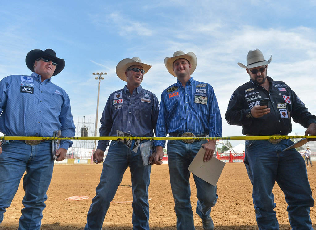 Justin Sheely | The Sheridan Press<br /> Rodeo athletes stand behind the tape for the meet and greet session during the Cowboy State Elite Rodeo Athletes premier tour at the Sheridan County Fairgrounds in Sheridan. Sheridan was the only stop in Wyoming for the premier tour of the ERA rodeo, which is comprised of some of the most prestigious rodeo athletes.