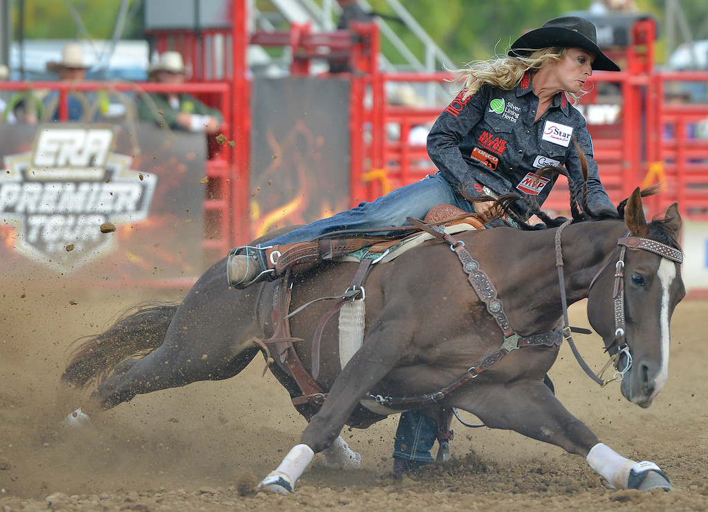 Justin Sheely | The Sheridan Press<br /> Ashley Schafer's horse slips in the barrel racing competition during the Cowboy State Elite Rodeo Athletes premier tour at the Sheridan County Fairgrounds in Sheridan. Sheridan was the only stop in Wyoming for the premier tour of the ERA rodeo, which is comprised of some of the most prestigious rodeo athletes.