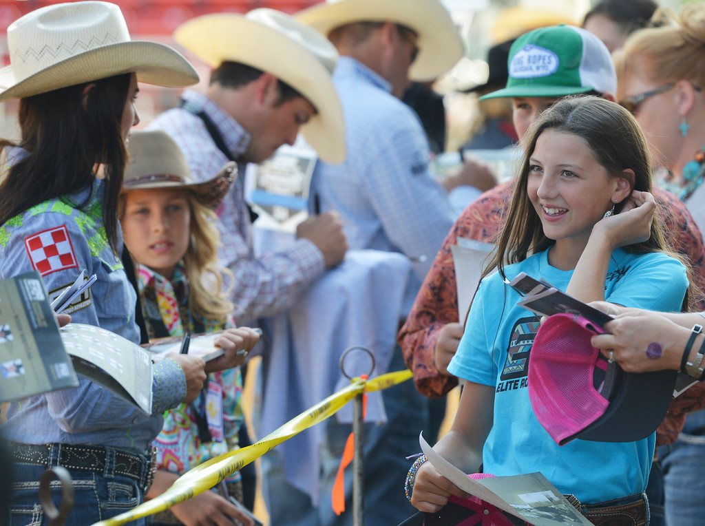 Justin Sheely | The Sheridan Press<br /> Eleven-year-old Faith Heim of Bismarck, North Dakota, gets in line for autographs for the meet and greet session with the athletes during the Cowboy State Elite Rodeo Athletes premier tour at the Sheridan County Fairgrounds in Sheridan. Sheridan was the only stop in Wyoming for the premier tour of the ERA rodeo, which is comprised of some of the most prestigious rodeo athletes.