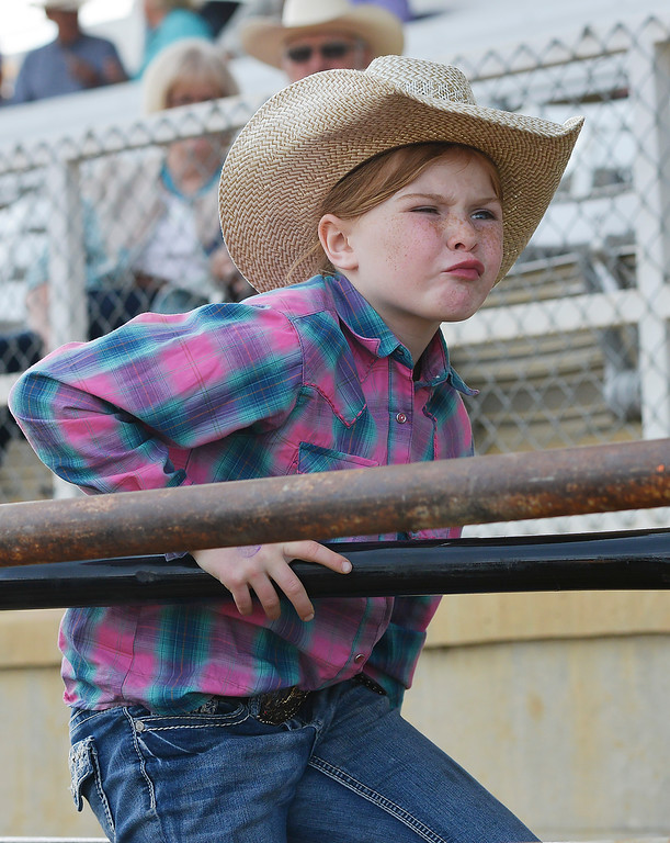 Justin Sheely | The Sheridan Press<br /> Eight-year-old Oakley Schater of Yoder, Wyoming, climbs a fence during the Cowboy State Elite Rodeo Athletes premier tour at the Sheridan County Fairgrounds in Sheridan. Sheridan was the only stop in Wyoming for the premier tour of the ERA rodeo, which is comprised of some of the most prestigious rodeo athletes.