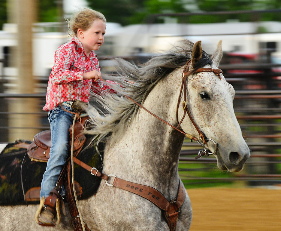 Six-year-old Karly Peterson races her horse home in the barrel racing event during the Sheridan Cowgirls Association Rodeo Thursday evening at the Sheridan County Fairgrounds.