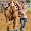 Bailey Cunningham dismounts in goat tying during the Sheridan Cowgirls Association Rodeo Thursday evening at the Sheridan County Fairgrounds.