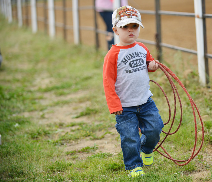 Two-year-old Tate Ohmstede walks with a rope in hand during the Sheridan Cowgirls Association Rodeo Thursday evening at the Sheridan County Fairgrounds.