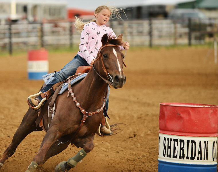 Ten-year-old Mackenzie Wood competes in barrel racing during the Sheridan Cowgirls Association Rodeo Thursday evening at the Sheridan County Fairgrounds.
