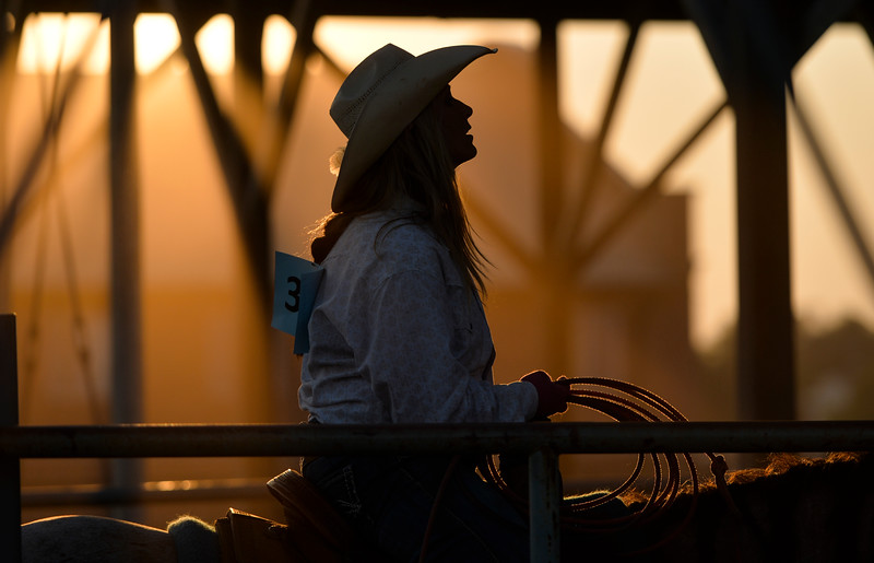 Justin Sheely | The Sheridan Press<br /> Julie MacCarty waits on her horse during slack at the Sheridan County Rodeo at the Sheridan County Fairgrounds Friday, Aug. 10, 2018.
