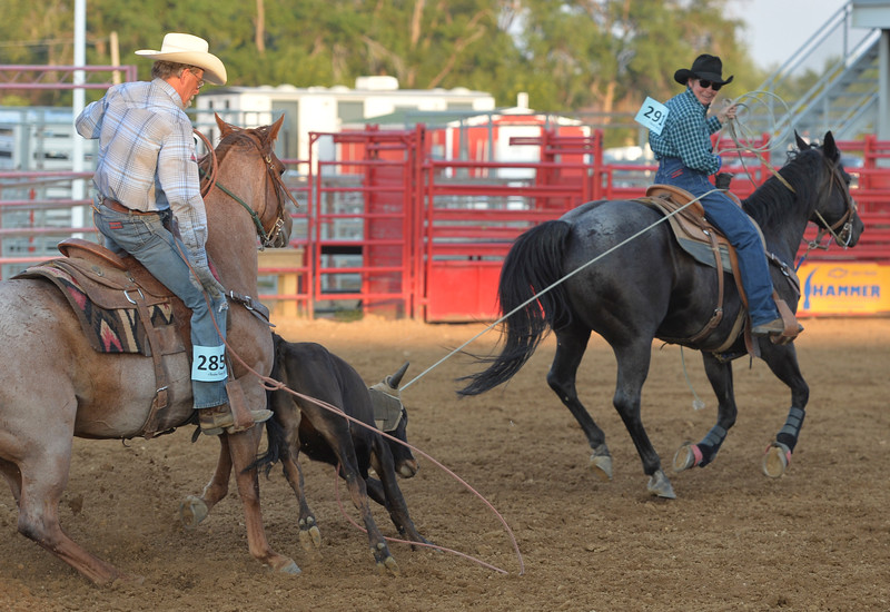 Justin Sheely   The Sheridan Press<br /> Gary Mefford, left, and Miff Koltiska compete in Century team roping during slack at the Sheridan County Rodeo at the Sheridan County Fairgrounds Friday, Aug. 10, 2018.