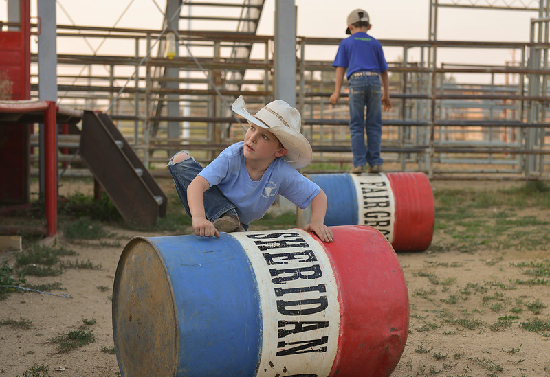 Justin Sheely | The Sheridan Press<br /> Five-year-old Waylon Brown, left, and Tilden Gorzalka, 7, play on barrels during slack at the Sheridan County Rodeo at the Sheridan County Fairgrounds Friday, Aug. 10, 2018.