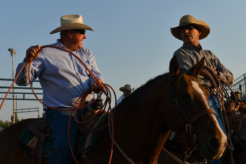 Justin Sheely | The Sheridan Press<br /> Leonard Gorzalka, left, visits with Mike Albrecht during slack at the Sheridan County Rodeo at the Sheridan County Fairgrounds Friday, Aug. 10, 2018.