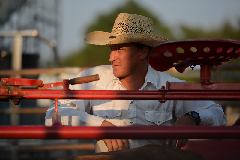 Justin Sheely | The Sheridan Press<br /> Joe Smith operates the roping chute during slack at the Sheridan County Rodeo at the Sheridan County Fairgrounds Friday, Aug. 10, 2018.