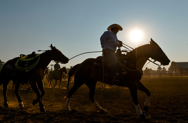 Justin Sheely   The Sheridan Press<br /> Ropers warm up in the second arena during slack at the Sheridan County Rodeo at the Sheridan County Fairgrounds Friday, Aug. 10, 2018.