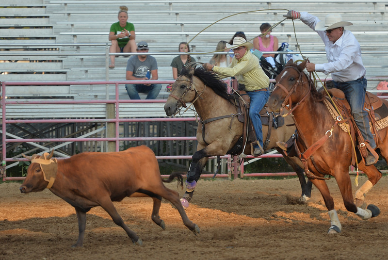 Justin Sheely   The Sheridan Press<br /> Heeler Jeff Hampton, left, and header Brian MacCarty compete in Century team roping during slack at the Sheridan County Rodeo at the Sheridan County Fairgrounds Friday, Aug. 10, 2018.