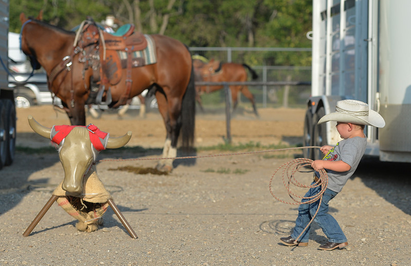 Justin Sheely | The Sheridan Press<br /> Two-year-old Clancy Dale practices some roping by his family's trailer during slack at the Sheridan County Rodeo at the Sheridan County Fairgrounds Friday, Aug. 10, 2018.