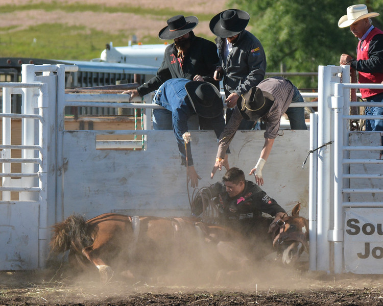 The horse jumped and fell in the shute and the rider was pinned beneath the horse., Enterprise, Oregon Rodeo