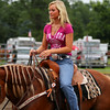 Rodeo woman, horse