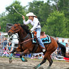 Woman barrel racing at the rodeo
