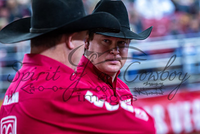 Pick-up men Mitch Coleman and Ricky Shannon discuss strategies to push the steers to the catch-pen during round 1 of the Steer Wrestling at CRC Finals
